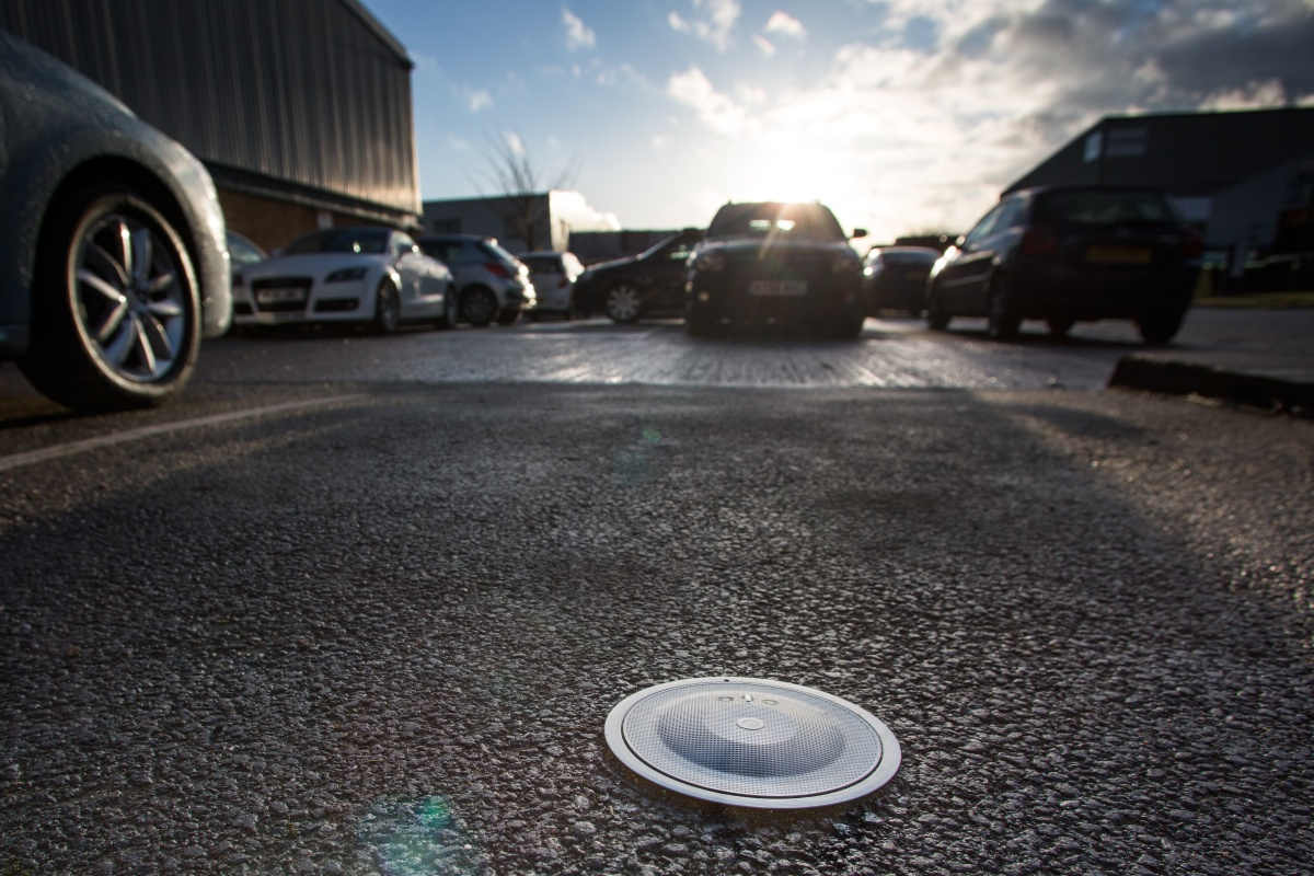 The detection sensors send data to the SmartCloud parking system