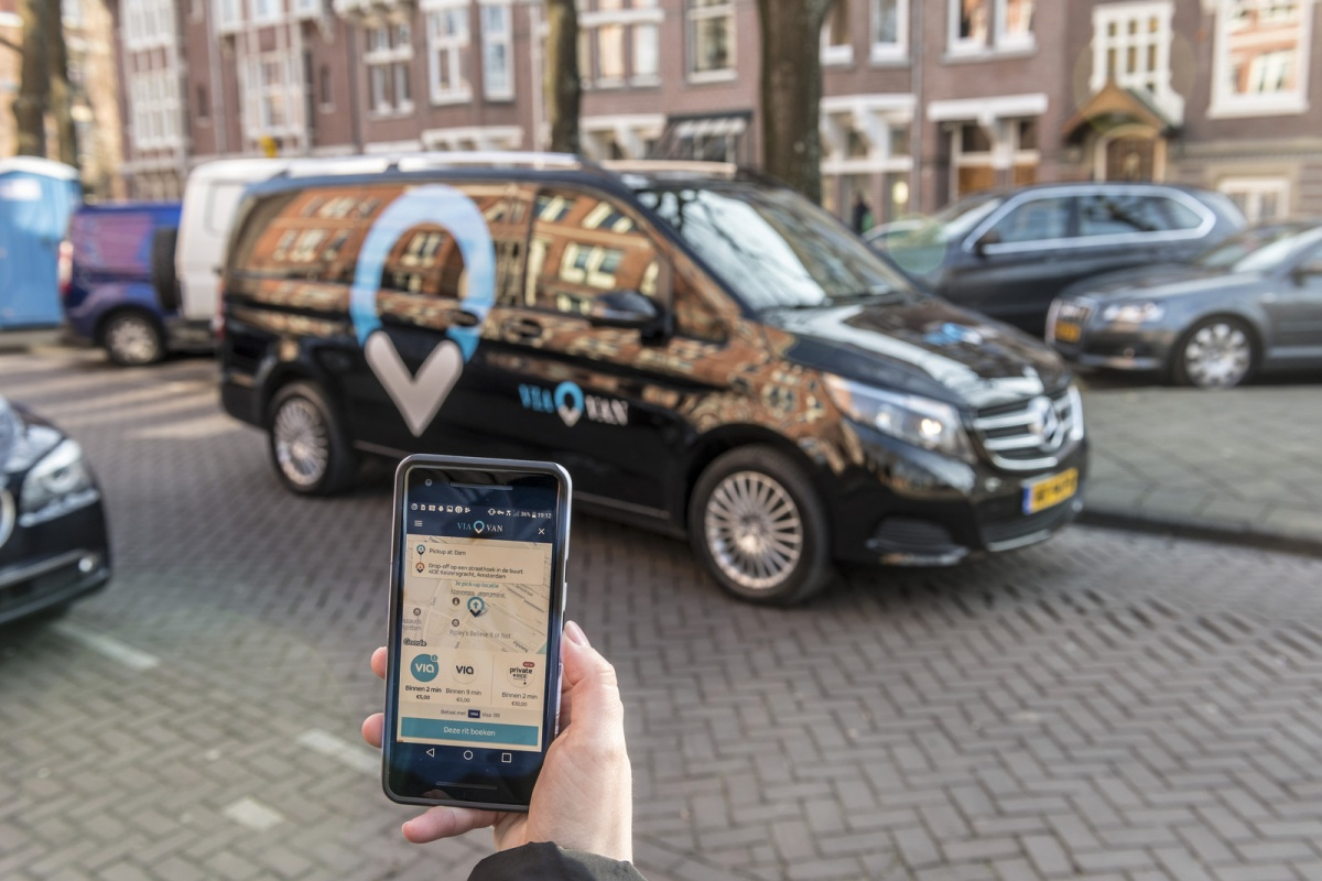 Passengers request a ride using the ViaVan app on their phone