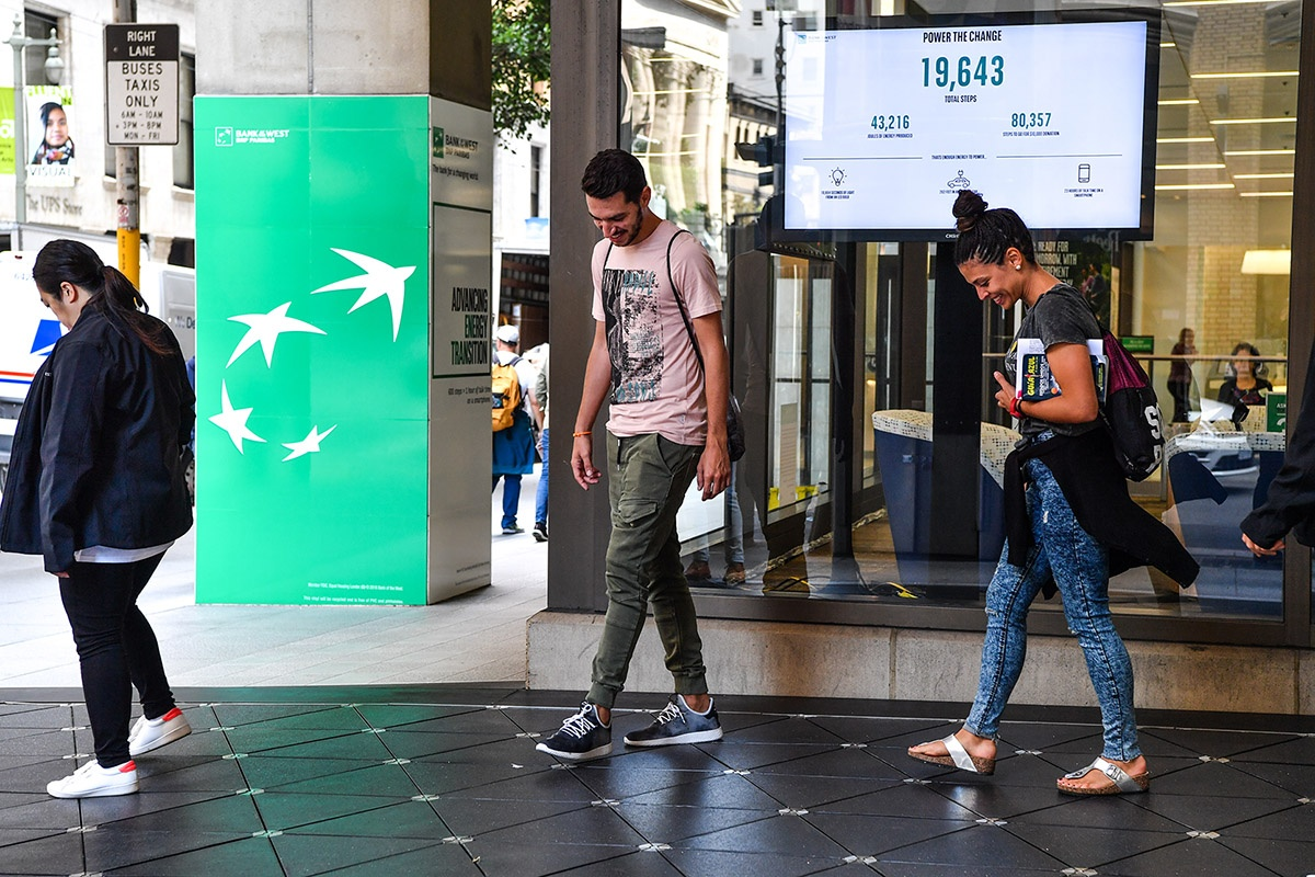 Pedestrians generate energy at one of the installations in San Francisco