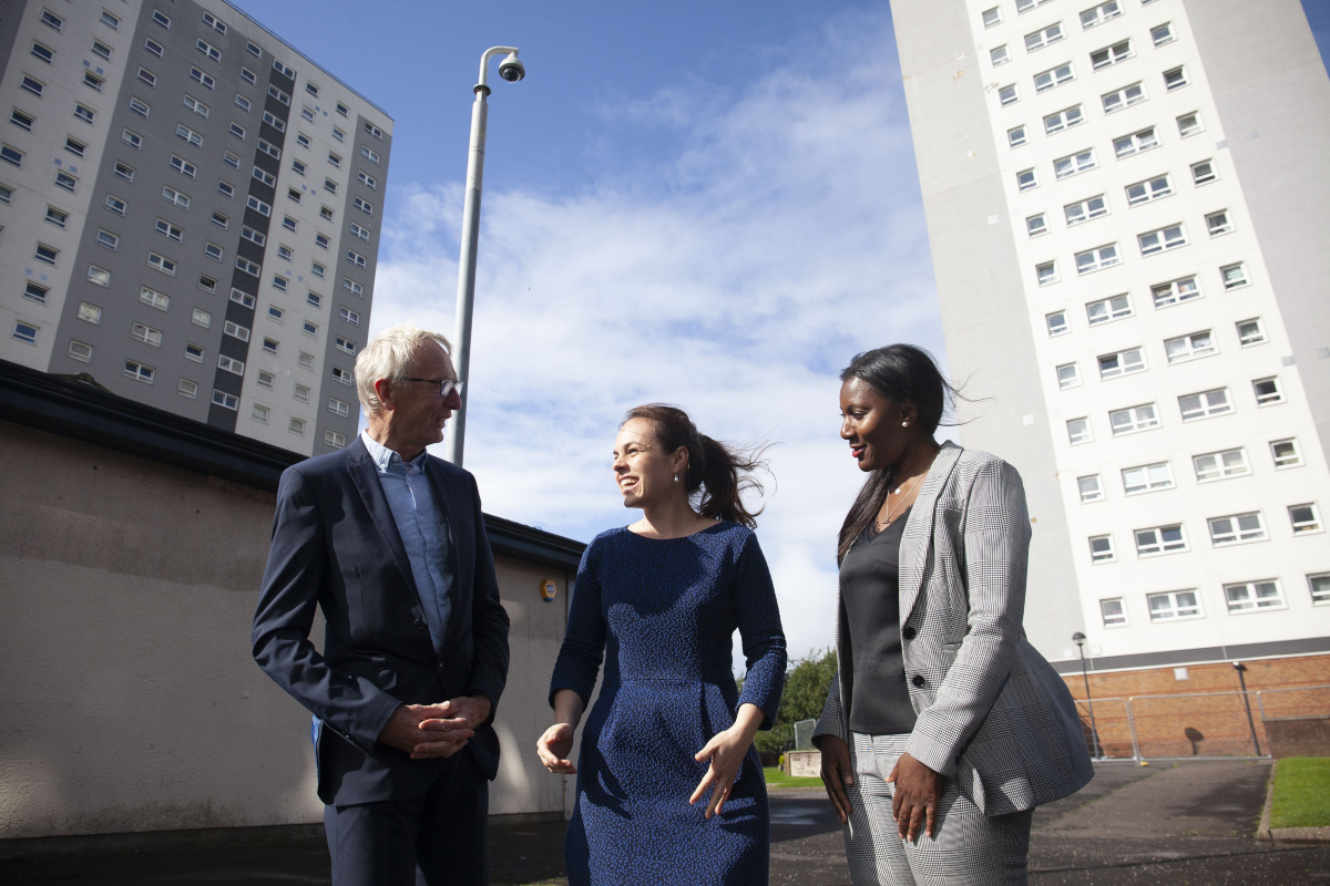 Kate Forbes MSP (centre) with Roger Popplewell and Jennifer Simon of Maryhill Housing